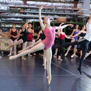 Photo of high school students participating in a ballet class