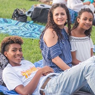 Photo of a family enjoying a performance at Wolf Trap